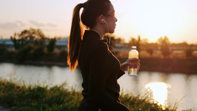 women drinking water after running in sunset time - push ups stock videos & royalty-free footage