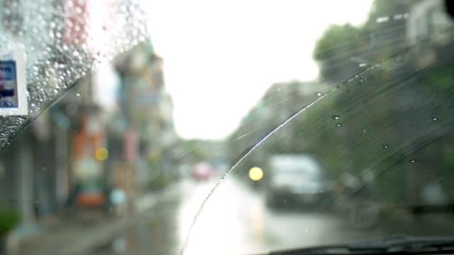 4K : Women driving  car during rain