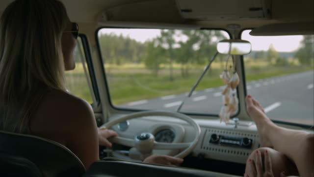 women driving in retro van - van vehicle stock videos & royalty-free footage