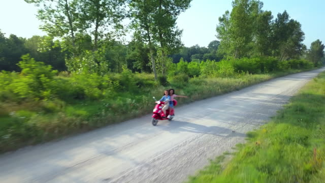 women driving motor scooter - scooter video stock e b–roll