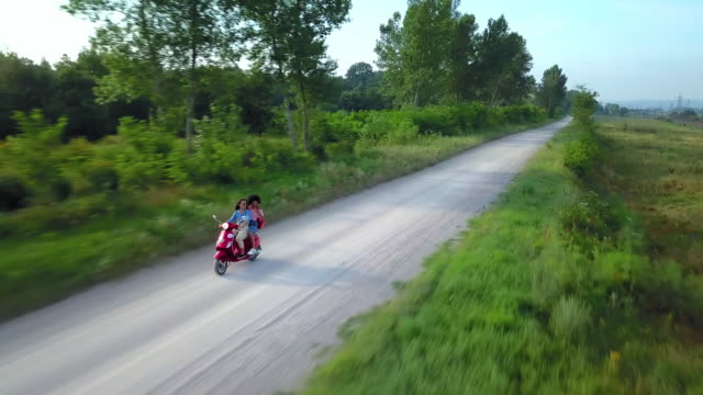 women driving motor scooter - perugia stock videos & royalty-free footage