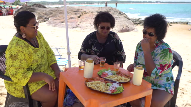 women eating and drinking at seaside restaurant on pedra de xaréu beach in pernambuco, brazil - northeastern brazil stock videos and b-roll footage