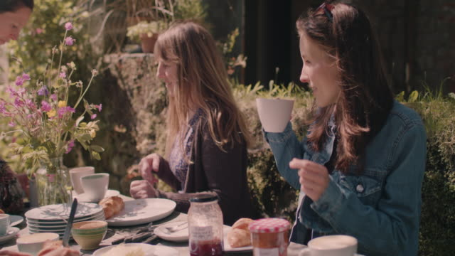 women eating breakfast outside summer - tea cup stock videos & royalty-free footage