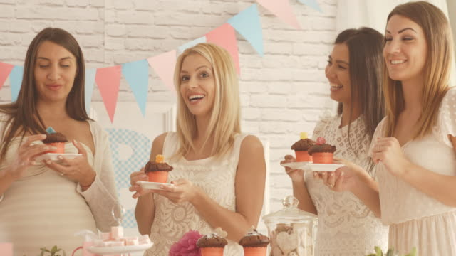 women eating muffins at baby shower party - baby shower stock videos and b-roll footage