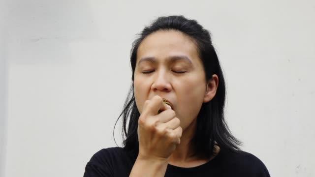 women eating rambutan slow motion - nutshell stock videos & royalty-free footage