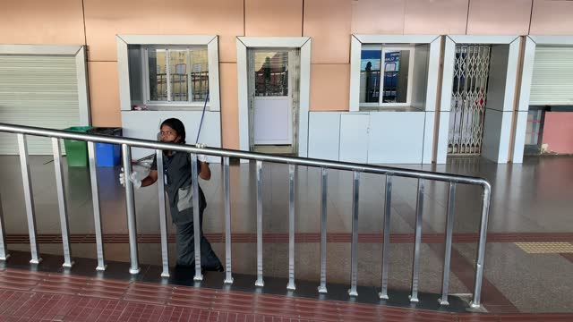 women employee of indian railway disinfect steel railing at a platform, due to the coronavirus pandemic, during the nationwide covid-19 lockdown, on... - underground station platform stock videos & royalty-free footage