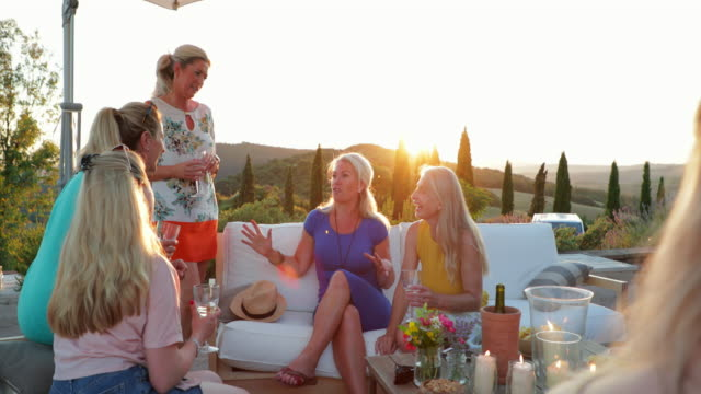 women enjoying evening drinks - patio stock videos & royalty-free footage