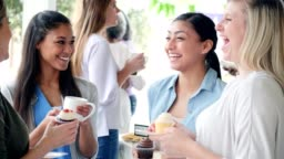 Women enjoying time together at a charity bake sale