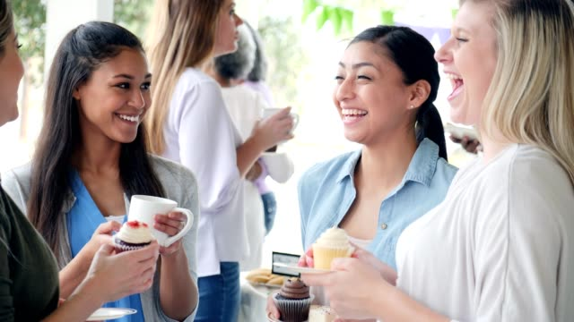 women enjoying time together at a charity bake sale - charity benefit stock videos & royalty-free footage