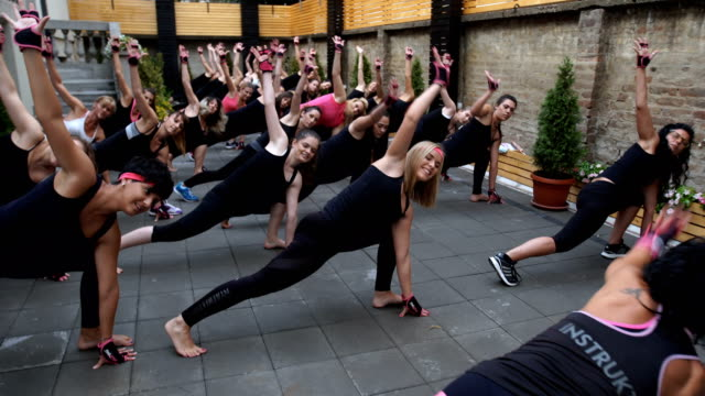women enjoying to exercise together - strongwoman stock videos & royalty-free footage