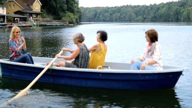 women enjoying while traveling on boat in lake - senior women stock videos and b-roll footage