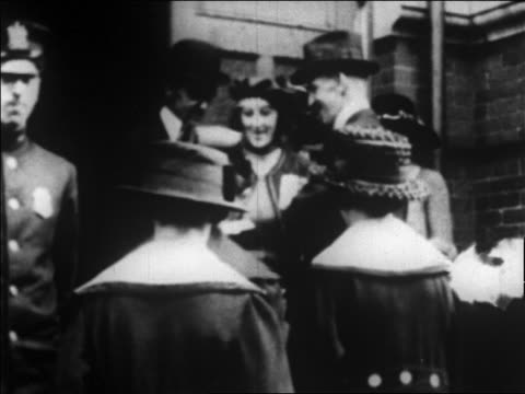 b/w 1920 women entering board of registry building / newsreel - voting stock videos & royalty-free footage