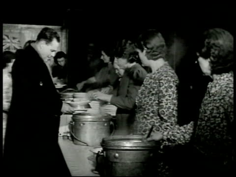 ENGLAND Women entering Community restaurant INT Restaurant w/ people going through serving line sitting at communal tables dining room VS Women...