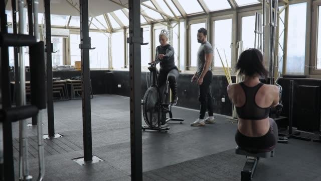 women exercising hard in gym - rowing machine stock videos & royalty-free footage