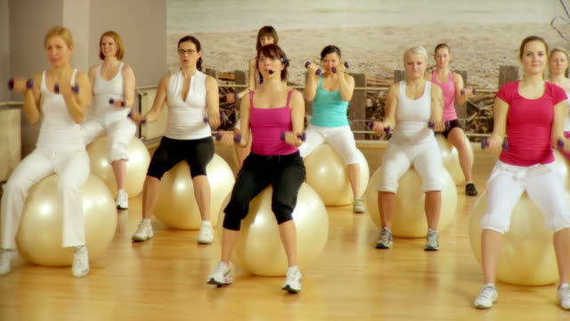 hd dolly: women exercising - aerobics stock videos & royalty-free footage