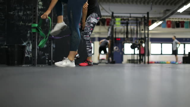 women exercising with resistance bands in gym - pampering self stock videos and b-roll footage