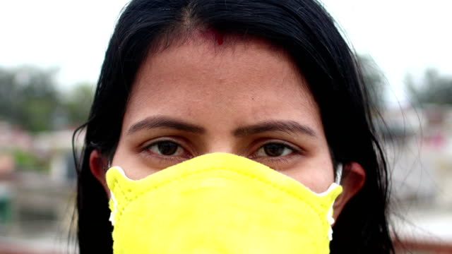 women face close-up with pollution mask against covid-19 - editorial stock videos & royalty-free footage