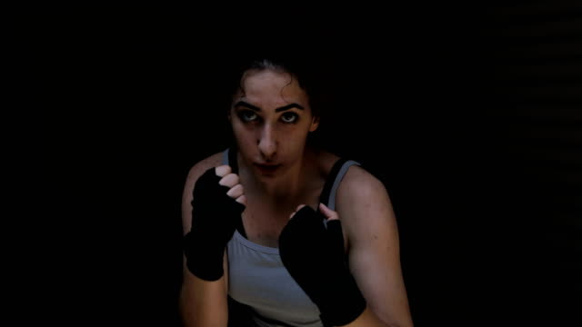 women fighter punching close up - combat sport stock videos and b-roll footage