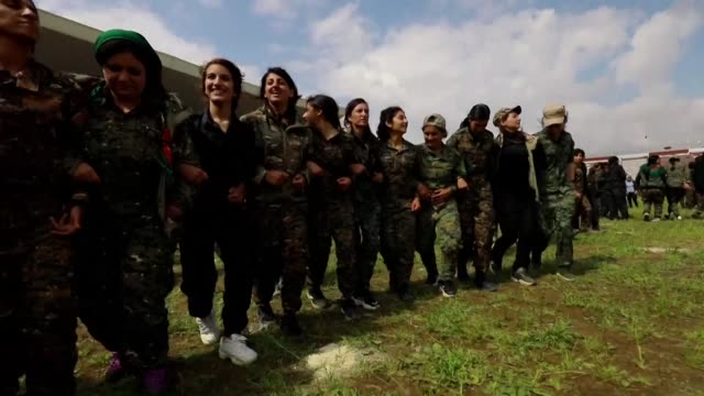 women fighters from the people's protection units celebrate the fall of the caliphate in the syrian province of hasakeh - people's protection units stock videos & royalty-free footage
