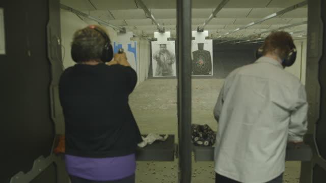 women firing guns at shooting range - target shooting stock videos & royalty-free footage