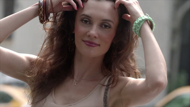 a women flirts with the camera. - young women stock videos & royalty-free footage