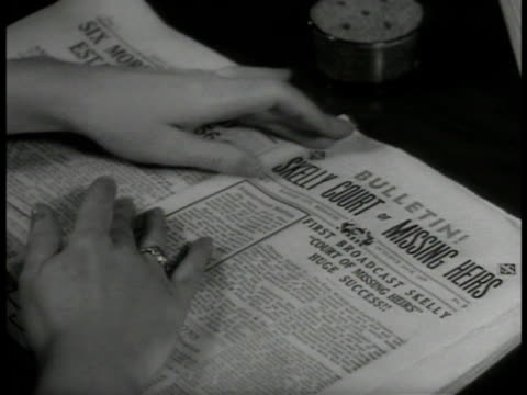 dramatization women folding 'bulletin' papers cu radio dial w/ broadcast short wave on face unidentified radio announcer behind cbs microphone saying... - hörfunksender stock-videos und b-roll-filmmaterial