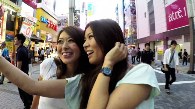 women friends in tokyo city streets, exploring and shopping in downtown - photography themes stock videos & royalty-free footage