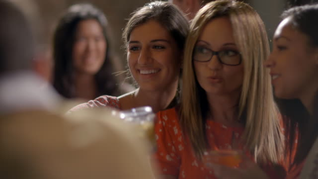 stockvideo's en b-roll-footage met women friends pose for smartphone selfie with drinks at bar - zelfportret fotograferen