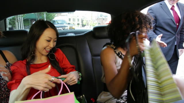ms women friendsgetting out of limo after shopping trip / nyc, new york, united states - getting out stock videos & royalty-free footage