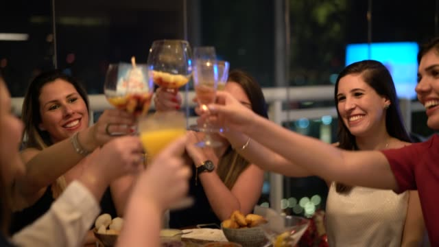 Women get together to enjoy a friendly dinner