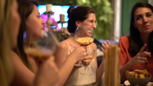 women get together to enjoy a friendly dinner - ladies' night stock videos and b-roll footage