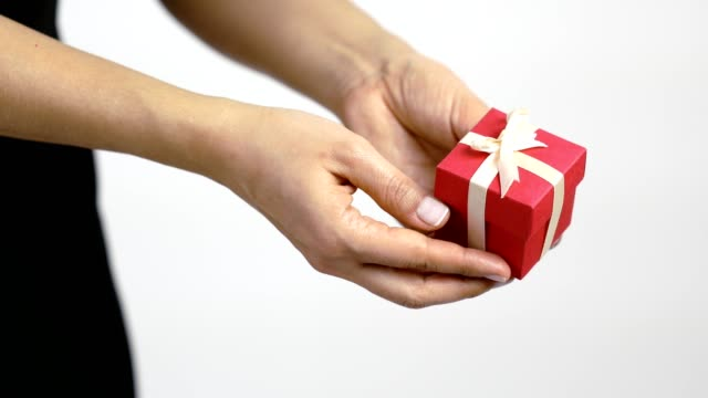 a women gives a present in red gift box with ribbon - birthday gift stock videos & royalty-free footage