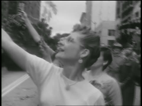 b/w 1954 women giving flowers to korean war soldiers on truck in parade / seattle / newsreel - 1954 stock videos & royalty-free footage