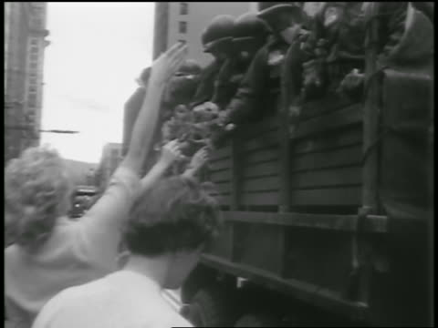 pan women giving flowers to korean war soldiers riding on truck in parade / seattle - 1954 stock videos and b-roll footage