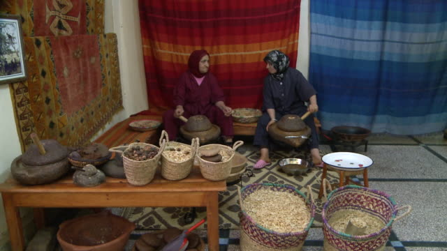 ms women grinding nuts / taroudant, unspecified, morocco - food and drink stock videos & royalty-free footage