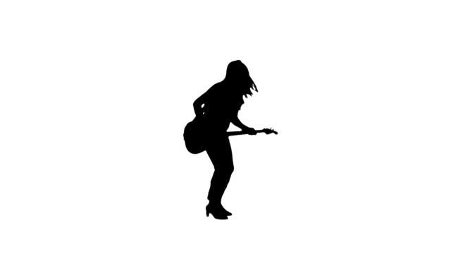 vidéos et rushes de silhouette de femme guitariste - guitariste
