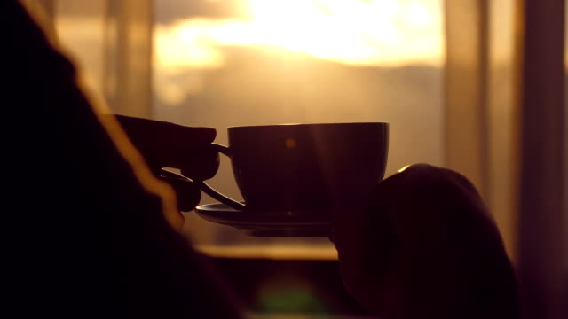 women hand holding a coffee cup - coffee cup stock videos & royalty-free footage