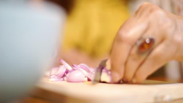 women hand sliced shallot - shallot stock videos & royalty-free footage