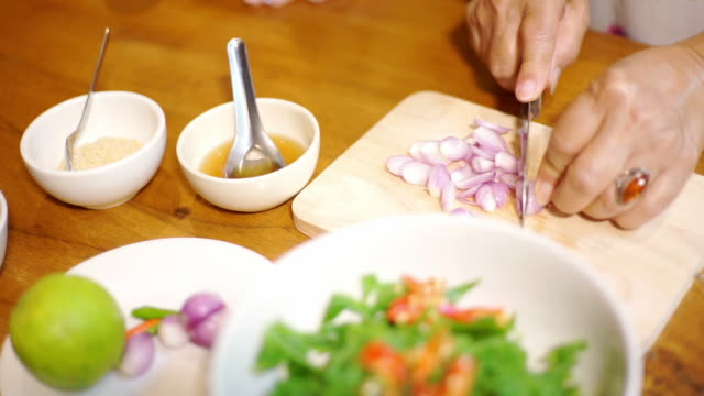 women hand sliced shallot with ingredients on the table - shallot stock videos & royalty-free footage