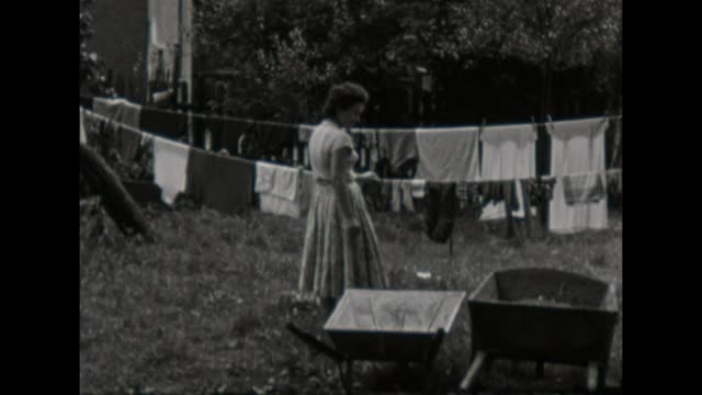 women hang up clothes for drying / shot in 1957 - only women stock videos & royalty-free footage