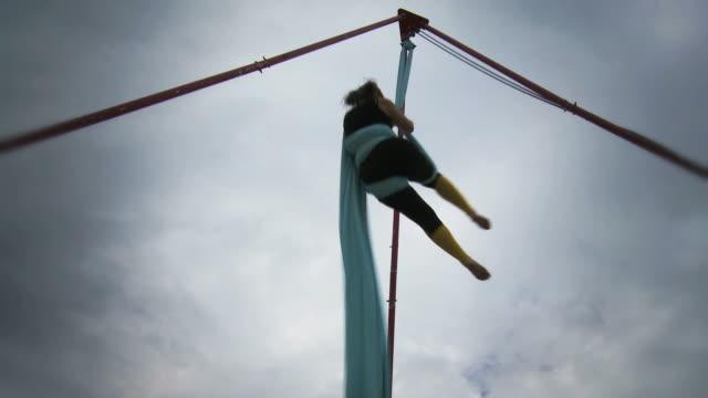 ws td tu women hanging and performing acrobat stunts  / mississauga, ontario, canada. - kelly mason videos stock videos & royalty-free footage