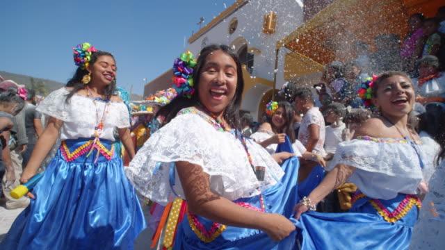 vídeos de stock, filmes e b-roll de women happily dancing during the zoque coiteco festival parade in chiapas, mexico - arte, cultura e espetáculo