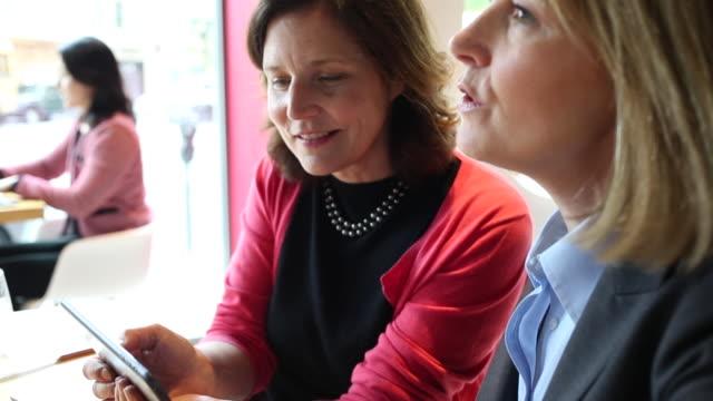 Women having a business lunch at a restaurant.