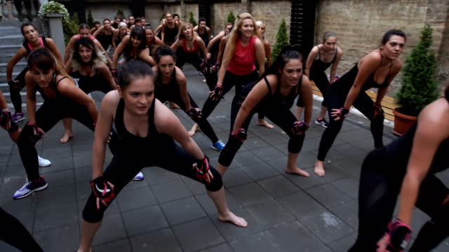 women having fun and  exercise together - strongwoman stock videos & royalty-free footage
