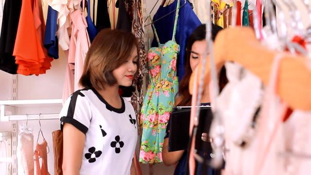 Women Having Fun Shopping In Boutique