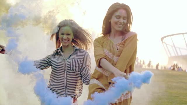 women having fun with smoke bomb/ katowice/ poland - powder paint stock videos & royalty-free footage
