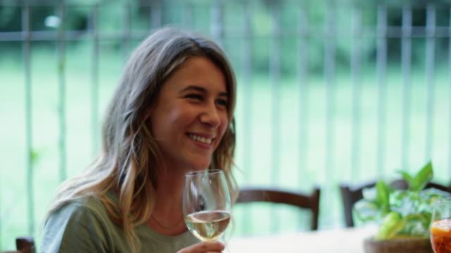 women having italian aperitivo together - aperitivo video stock e b–roll
