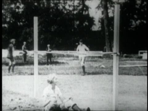 1920 WS Women high jumping over bar / Paris, France