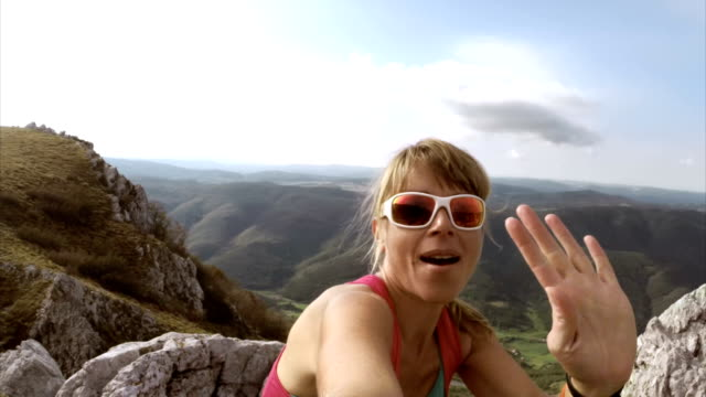 Women hiker making a video call to friend