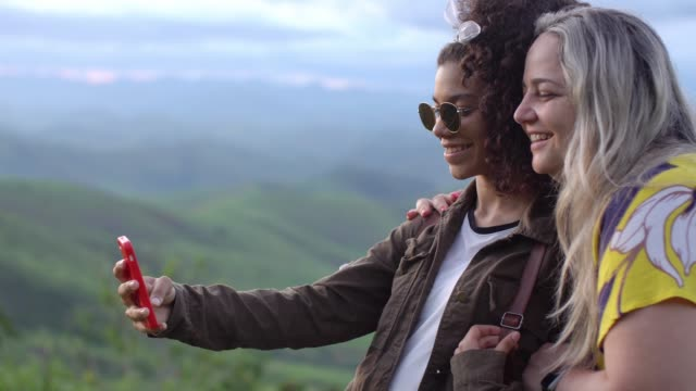 women hiking take selfie portrait at mountain top - photographing stock videos & royalty-free footage